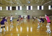Members of the Baldwin High School volleyball team work on a passing drill during practice last week. The Bulldogs will scrimmage BHS alumnae at 5 p.m. Friday at the BHS gym. The event is open to the public and free of charge. It will be the final tune-up before they open the season Tuesday at Bonner Springs.