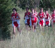 A pack of runners, including Tonganoxie High's Dalton Lawson, Caleb Himpel, David Powell, Joel Dunning and Dalton Harrington, wind their way through the THS course on Thursday afternoon's duel with Lansing.