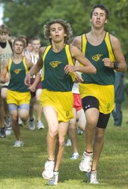 Micheal Torrez (center) kept his pace to finish eighth while Bryce Garver (right) finished 15th in the boys run.