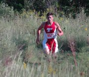 Matt Brock winds his way through the Tonganoxie cross country course on his way to finishing second in the Chieftains' dual with Lansing.