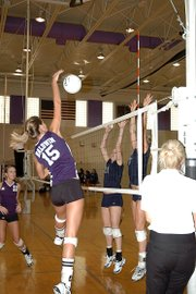 Baldwin High School sophomore Lyndsey Lober spikes a ball over Topeka-Hayden players.