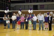 The Baldwin High School volleyball team celebrated its senior night last week before its match with Tonganoxie. The seniors, from left, are manager Hannah Elder, Ashley Hadl, Leigh Schenewerk and Olivia Catloth.