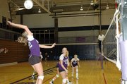 Baldwin High School senior Olivia Catloth, left, hits a ball during the Bulldogs' match versus Tonganoxie.