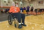 Dick Burns waves to the crowd after being recognized last January during the Dick Burns Classic wrestling tournament. The former teacher and wrestling coach at Bonner High School died this week at the age of 74.