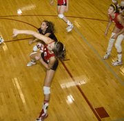 Abby Eisman follows through on a spike at the Tonganoxie Invitational on Saturday afternoon.