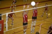 Haley Smith and Molly O'Hagan elevate to block a Eudora spike on Saturday afternoon at the Tonganoxie Invitational.