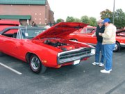 Spectators check out the different cars on display at the 2006 Project Grad Car Show. Hot rods and muscle cars will be taking over the parking lot of Basehor-Linwood High School Saturday, Oct. 11, for the 11th Annual Project Grad Car Show