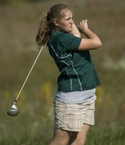 Rachel Van Fleet watches her ball leave the tee box area of the fifth hole Thursday in the Basehor-Linwood Girls Golf Invitational.