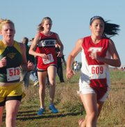 Tonganoxie High sophomore Alex Hauk runs in the Kaw Valley League race on Thursday in Tonganoxie.