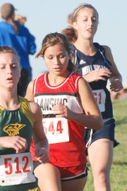 Lansing High junior Melanie Pilkington works her way through the pack during the Kaw Valley League championships. Pilkington and the Lions defended their cross country league title.