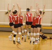 The Tonganoxie High volleyball team performs ist post-ace celebration jump on Saturday at the KVL tournament.