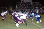 Baldwin High School, left, squared off with Perry-Lecompton Friday night in a Class 4A district football game. Baldwin opened the game with a 21-0 lead, but Perry-Lecompton rallied with 28 unanswered points. However, Baldwin finished the game on a 14-0 run to win, 35-28.