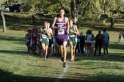 Baldwin High School freshman Brian Wright leads the main pack of runners Saturday at the regional meet. Wright finished runner-up in the race to teammate Tony Weiss as BHS won both team titles.