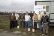 A short ceremony was held Thursday in the Wolf Creek Junction development to recognize the start of work on a new Basehor grocery store, Wolf Creek Marketplace, which is in the early stages of construction behind the group. Pictured are, from left, Bill Huninghake with Affiliated Foods Midwest, Bill Gillmor of Citywide Development, Basehor City Administrator Carl Slaugh, Dennis Monahan of First National Bank of Olathe, Basehor Mayor Chris Garcia, grocery store owner and developer John Bell, grocery store owner and developer Ed McIntosh, grocery store owner Kevin Barclay and Rich York of Affiliated Foods Midwest. The grocery store is expected to open in early summer 2009 if everything remains on schedule.