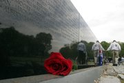 A single rose sits along the Vietnam Veterans Memorial in Washington, D.C. The memorial was one of several stops for Kansas veterans during an April 30 Honor Flight to the nation's capital.