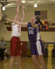 Alissa Donnelly draws a foul from a Piper defender during the TMS seventh grade girls' 35-15 loss on Thursday.