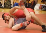 TMS eighth-grade wrestler Deepak Grewal grapples at the Warriors' home dual on Nov. 19.