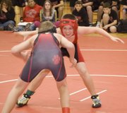 TMS eighth-grade grappler Garrett Elston sizes up his Lansing opponent on Nov. 19 at TMS.