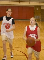 Lauren Hall goes in for a layup at Tonganoxie girls basketball practice.