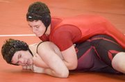 TMS seventh-grade wrestler Shane Levy holds his opponent to the mat on Nov. 19.