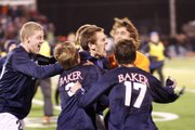 Several Baker University men's soccer players celebrate their overtime victory Saturday night. Baker defeated Park University 1-0 to advance in the NAIA national tournament.