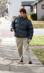 Greg Rogers uses his cane, his ears and his memory to navigate around Baldwin City and the Baker University campus.