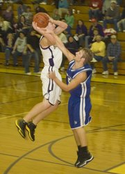 McLouth High senior forward Derrick Crouse elevates over a St. Marys defender for a jump shot during the Bulldogs' 63-20 loss to the Bears on Friday night at McLouth.