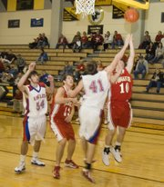 Jeremy Carlisle attempts a reverse layup against Wellsville during the fourth quarter of Tonganoxie's 52-37 victory on Friday afternoon.