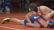 Justin Crotty, 125-pound junior Tonganoxie High grappler, forces his opponent to the mat Thursday night at THS. Crotty was one of six Chieftain wrestlers to score a victory in a 44-33 loss to the Chargers.