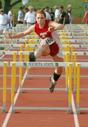 Tracie Hileman set Tonganoxie High track and field records in four categories.