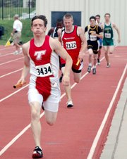 Jeremy Carlisle combined with  three other Tonganoxie High 4x400 runners to set a new school record.