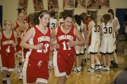 Tonganoxie High seniors Chrissie Jeannin and Roni Grizzle run off the floor following the Chieftains' narrow defeat of Bishop Ward at Kansas City, Kan., on Friday night. The two seniors combined for 33 points in the 48-46 THS victory.