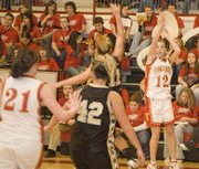 Tonganoxie High junior Abby Eisman follows through on a jump shot during the Chieftains' 48-28 victory against Turner at THS on Tuesday night.
