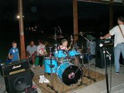 Tyler Kelly, at age 9, plays drums with a band during the 2001 AutumnFest event in Edwardsville. Tyler learned to play drums from his father who also plays drums. Tyler got his first paying gig at age 11 and now plays regularly with his band Mr. Fish.