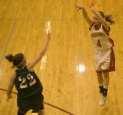 Lauren Hall puts up a three-pointer on Tuesday against De Soto. Hall came off the bench and scored seven points for THS.