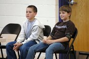 Baldwin Elementary School Intermediate Center fifth graders Nick Pattrick, left, and Dalton Good were the finalists in the school's spelling bee last week. Good won the contest and will advance to the Douglas County Spelling Bee on Feb. 7.