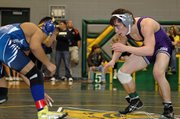 Baldwin High School senior Alan Callahan, right, squares off against Junction City's Isaac Ruiz in the 112-pound championship Saturday evening at the Bobcat Classic.