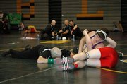 Baldwin High School senior Colin Busby attempts to pin a Tonganoxie wrestler Saturday at the Bobcat Classic.