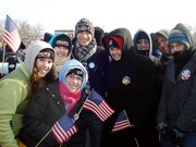 Baker University students, from left, Sarah Luecke, Stephanie Brockman, Shannon Pulkrabek, Adam Kenne and Emily Stephens braved the cold to fly their flags and take in Barack Obama's inauguration as part of their interterm class.