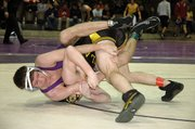Baldwin High School senior Andy Thurlow, left, locks his opponent into a cradle Saturday. Thurlow finished sixth in the 135-pound weight class.