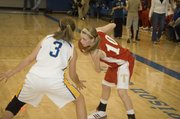 Lauren Hall looks for an open teammate during Tonganoxie High's 46-36 victory at Perry-Lecompton on Friday night.