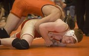 Steve Davis is taken down in the 189-pound championship match at Abilene on Saturday night. Davis was pinned by Clay Centers Joel Marrs, ranked No. 1 in Class 4A.