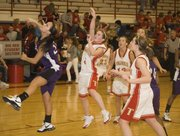 Andie Jeannin puts up a shot in the paint for Tonganoxie High during the team's 54-36 loss on Friday against Piper.