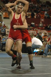 Matt Brock tries to escape the grasp of his opponent at the state wrestling tournament.