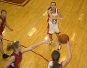 Abby Eisman moves the ball around the perimeter for Tonganoxie. The Chieftains had eight players score in their sub-state win over Hiawatha.