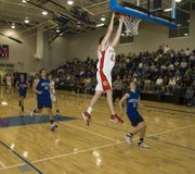 Austin Smith gets up for a two-handed jam that helped send THS to a 63-54 win over Holton.