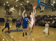 Keaton Schaffer scores a pair of his eight fast-break points for Tonganoxie during the Chieftains' win against Holton.