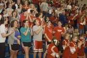 Tonganoxie High fans erupt after Austin Smith's dunk in the closing moments of the Chieftains' victory over Holton.