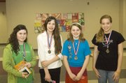 Top readers in each class were recognized as part of Tonganoxie Middle School's Read Across America program. From left are Sara Krapp, Celeste Bartels, Megan Briggs and Monica Maurer.