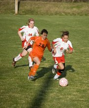 Shyanne Gergick chases down a Bonner Springs defender during Tonganoxie's 2-0 win on Monday at Chieftain Park.